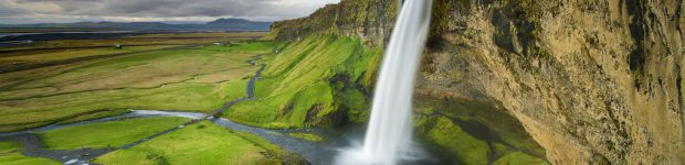 Climb behind Seljalandsfoss waterfall for an incredible view.